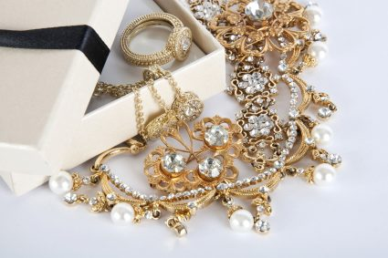 Box with Jewelry on a white background. Jewel. Pearl. Gold ring, and diamonds - Shira Diamonds